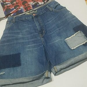 Old Navy Distressed patched up shorts .